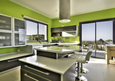 Modern green kitchen with ocean view
