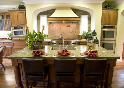 Luxury home kitchen with a granite island.