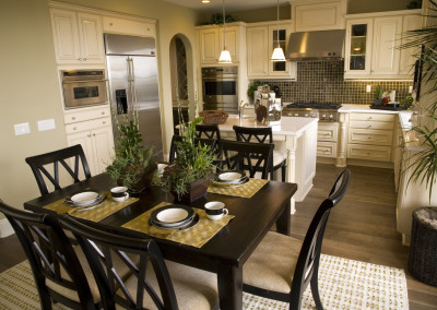 Estate kitchen with a festive dining table.