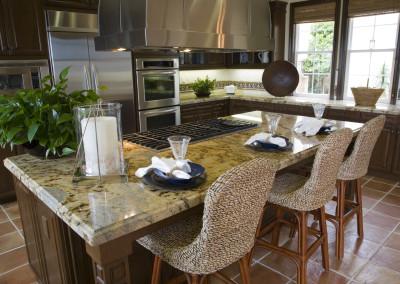 Modern designer kitchen with brown tiles.