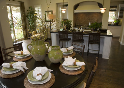 Kitchen and breakfast table with modern tableware.